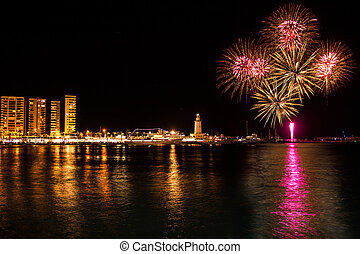 Fireworks in Malaga - Fireworks over lighthouse on the...