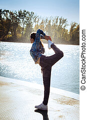 woman extrem stretch - young woman in tracksuit stretching...