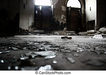 broken glass on the lobby floor of an abandoned apartment...
