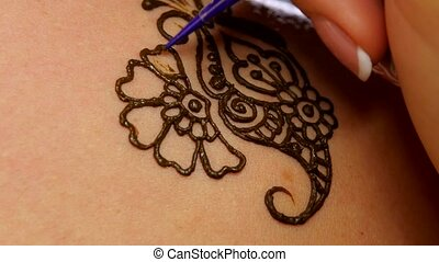 Last and finishing process of applying mehendi on female back