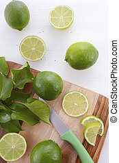 Limes on chopping board.