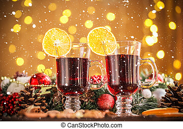 Christmas hot mulled wine with spices on a wooden table with...
