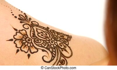 Drawing process of henna mehendi ornament on shoulder -...