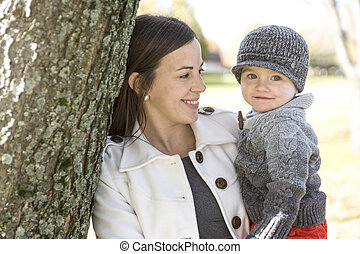 happy young mother and her son spending time outdoor in the...