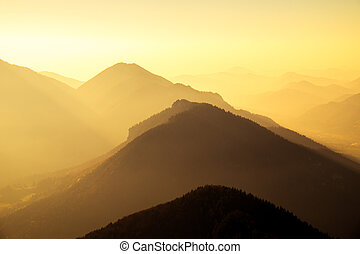 Scenic view of mountains and hills silhouette at sunset,...