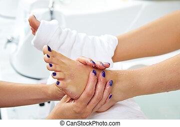 foot scrub pedicure woman leg in nail salon on chair sofa