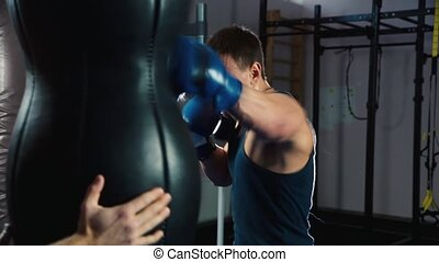 Boxing training. Close up of a boxer: who trains