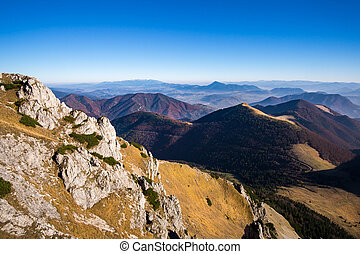Scenic view of misty mountains in fall, Slovakia - Scenic...