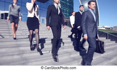 Business people go down stairs - Team of diverse business...