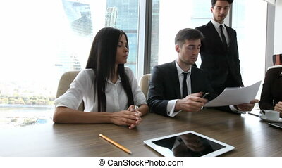 Business partners discussing report - Group of business...