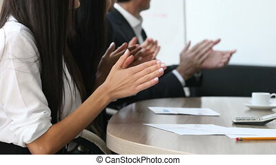Hands applauding at meeting