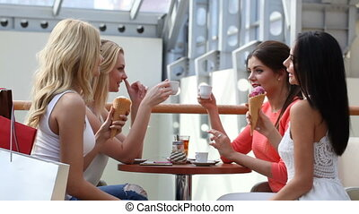 Friends talking in cafe