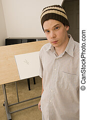 Portrait of Artist in Front of Drawing Table.