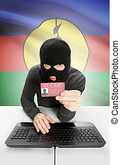 Hacker with flag on background holding ID card in hand - New...