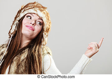 Attractive woman in fur cap - Winter female fashion Portrait...