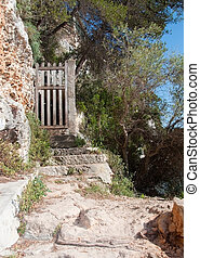 Old wooden gate on a sunny summer day in Mallorca, Balearic...