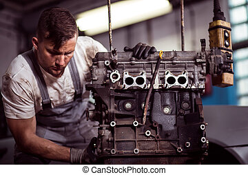 Engineer fixing engine - Mechanist is checking car engine at...