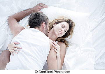 Passionate lovers having morning sex