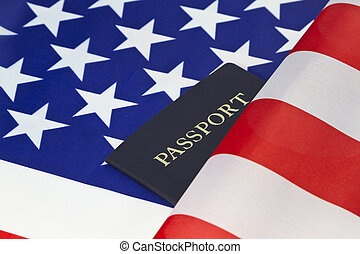 American flag and passport reflect pride of citizenship -...