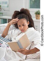 Girl reading an interesting book - Girl in white robe...