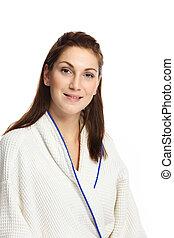 Smiling woman wearing a bathrobe