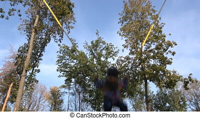 Little Girl Jumping On Tampoline. In Action