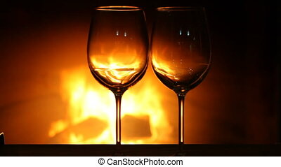 Wine glasses near fireplace - Empty wine glasses standing...