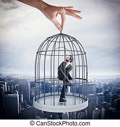 Caged businessman - Businessman sitting in a cage of birds