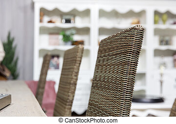 Wicker chairs in room - Wicker chairs in home interior close...