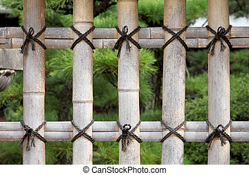 bamboo fence - close up of bamboo fence in a Japanese garden...