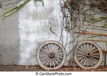 wooded wagon wheel - Antique and weathered wood cart wheel...