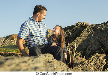 Father with is daughter at the sunset