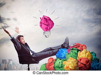 Exult for idea - Businessman sitting with pile of tangle...