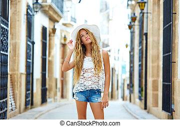 Blond tourist girl in mediterranean old town