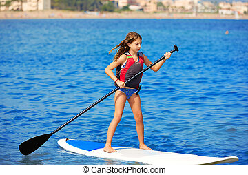 Kid paddle surf surfer girl with row in the beach - Kid...