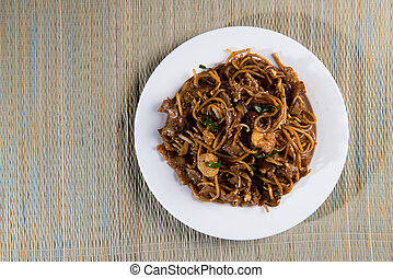 Fried Penang Char Kuey Teow top down view which is a popular...