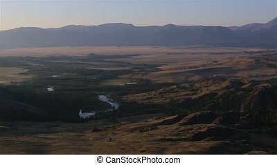 Panorama of Kuray steppe and North Chuya ridge at dawn -...
