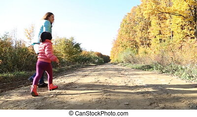 walk mother with a baby in nature - Mom and daughter are on...
