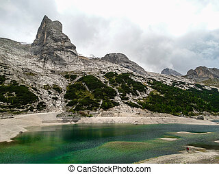 Dolomite alps Italy Mountain lake - The Dolomites are a...