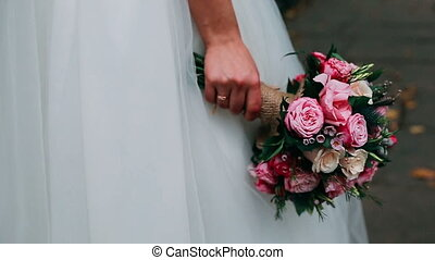 Bride with bouquet, closeup - Bride holding a bridal bouquet...