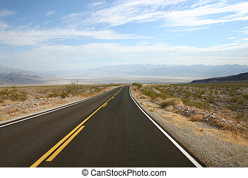 Empty road  - Empty highway in Death Valley in USA