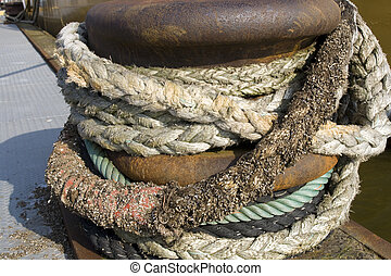 Ropes on dock - different kind of ropes tied on dock