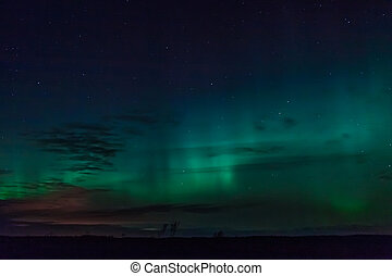 Autumn Aurora - The aurora borealis seen early on an autumn...
