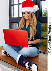 christmas, x-mas, online shopping concept - woman in santa...