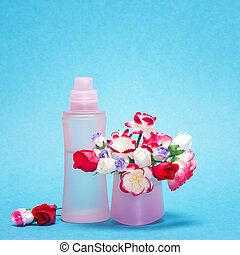 Floral fragrance Pink glass perfume bottle and bouquet of...