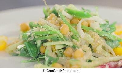 cucumber, corn and tomatoes salad rotates on a plate