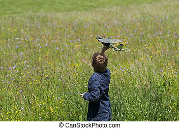 Remote control - Teen boy having fun with RC plane
