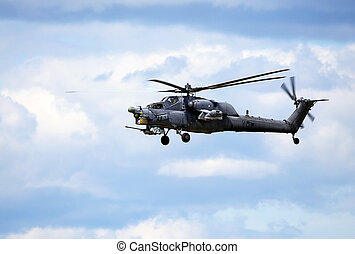 Combat helicopter in flight - Perform flight by the modern...