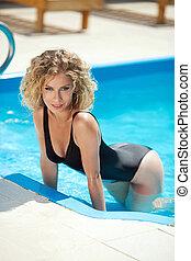 Beautiful sensual woman in bikini resting and tanned in...