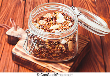 Granola in jar - Granola in a jar on the wooden table close...
